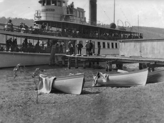 The era of steamships and wooden rowboats on Keuka Lake in early 1900s. This photo is of Keuka Landing, a busy steamship hub, now called Keuka Village, near the Switzerland Inn.