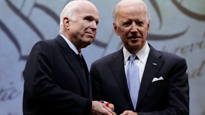 Joe Biden presents the Liberty Medal to John McCain in October 2017. The men were opponents politically but friends personally.