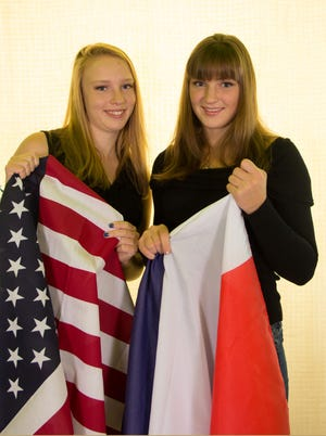 Our French exchange student Constance switches flags with Margo.