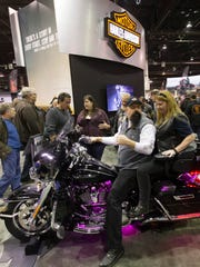 People check out a 2017 Harley-Davidson motorcycle at the Progressive International Motorcycle Shows at the Donald E. Stephens Convention Center in Rosemont, Ill., in February 2017.
