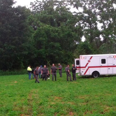 Police gather around David Sweat after he was shot