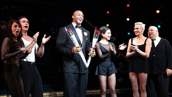 "Eddie George takes his first bow after a performance of ""Chicago"" on Broadway at Ambassador Theatre in New York City."