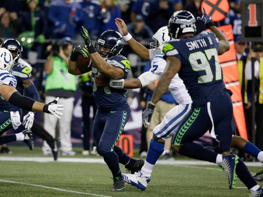 Seahawks linebacker Bobby Wagner returns the fumble forced by Marcus Smith for a touchdown.