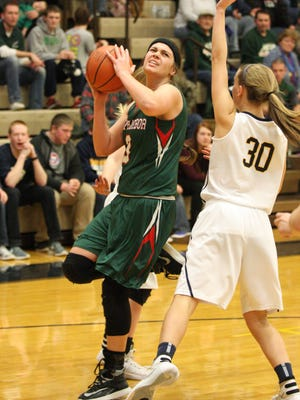 Oak Harbor's Andrea Cecil shoots Saturday as Woodmore's Carly Rothert defends.