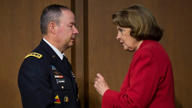 National Security Agency Director General Keith Alexander chats with Democratic Senator from California Dianne Feinstein  before a Senate Intelligence Committee Hearing on 'Continued Oversight of the Foreign Intelligence Surveillance Act.' i