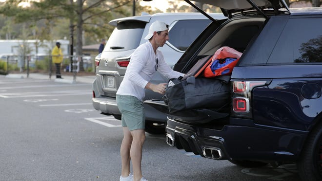 Rory McIlroy packs his vehicle Friday after the PGA Tour canceled the rest of The Players Championship golf tournament as a result of the coronavirus pandemic.