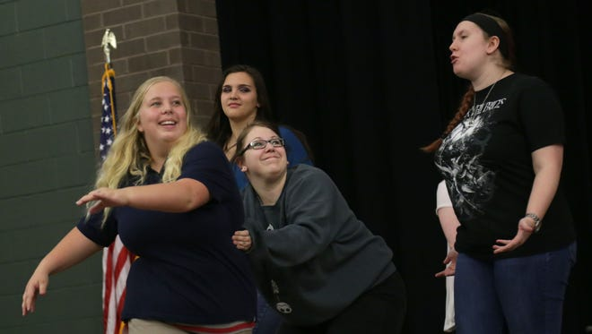 Courtney Hardy, from left, Alexis Hyatt, Kaitlyn Stransky and Kat Conley rehearse 'The Rehearsal' at Madison Middle School.