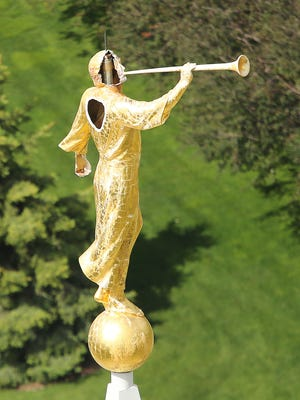 Lightning struck the Moroni statue on top of the Mormon temple in Bountiful, Utah, Sunday, May 22, 2016. The gold statue lost part of its head and back in the Sunday afternoon lightning strike.