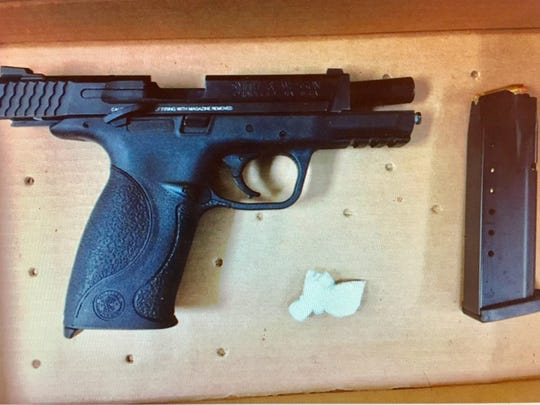 This Friday, Sept. 8, 2017 screen-shot photo shows a loaded, .40-caliber Smith & Wesson handgun with clip and a quantity of crack cocaine. Salisbury police said the drug and weapon were in the possession of Jermaine Dupont of Millsboro during a traffic stop on North Salisbury Boulevard.