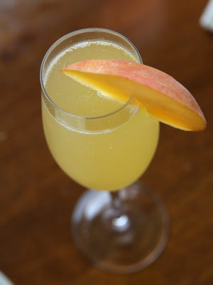 Moms can get a free mimosa on Mother's Day with the Ibotta smartphone app.