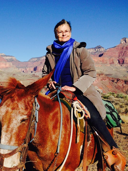 Chris Schuh on a mule in the Grand Canyon
