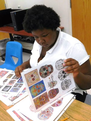 Ashtiegn Jones gathers inspiration for her own artwork from a variety of sugar skull designs.
