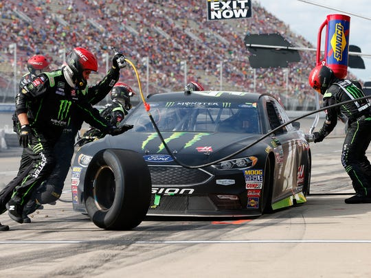 Kurt Busch, driver of the #41 Monster Energy/Haas Automation Ford, pits during the Monster Energy NASCAR Cup Series Pure Michigan 400 at Michigan International Speedway on August 13, 2017 in Brooklyn, Michigan.
