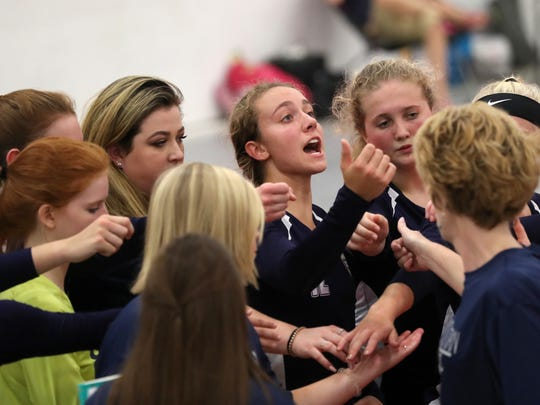 Community Christian's Abbie Post leads a chant on the sidelines during their match against NFC at the ProStyle Volleyball Academy on Tuesday.
