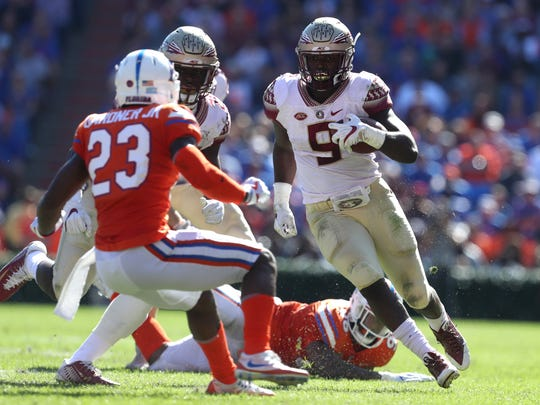 FSU's Jacques Patrick runs the ball against Florida during the Seminoles 38-22 win at Ben Hill Griffin Stadium in Gainesville on Saturday.