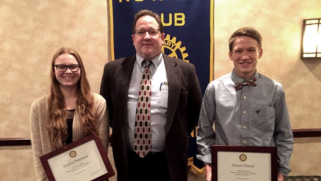 Chambersburg Rotary President Bill Tolleson, center, poses with January Students of the Month Syerra Freeman, left, and Owen Maier, right.