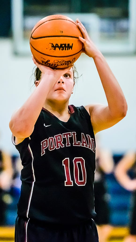 Olivia Roe of Portland lines up a freethrow that would put Portland up 49-43 over Grand Ledge with 2 minutes remaining in the 4th quarter of their season opening game Tuesday December 1, 2015 in Grand Ledge.