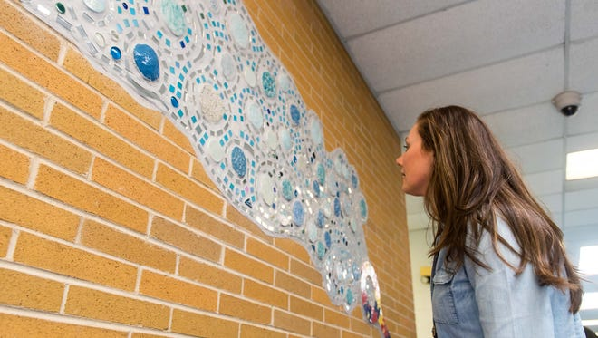 Winslow art teacher Kara Rehm helps a student find his bubble in the Bubble Wand installation art at Winslow Elementary in Vineland on Tuesday, April 4.