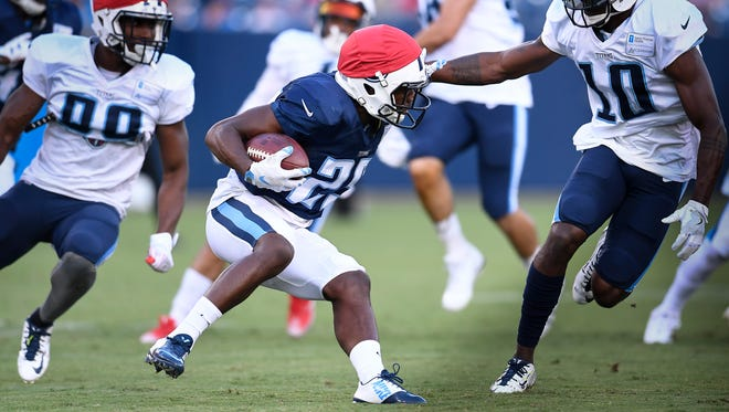 Titans cornerback Adoree' Jackson (25) tries to get past special teams defenders as he returns a punt during a training camp scrimmage at Nissan Stadium Saturday, Aug. 5, 2017 in Nashville , Tenn.