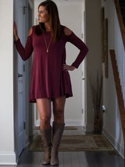 Annie Zeccola wears an off-the-shoulder dress by Alya from Francesca's with BP high suede boots from Nordstrom.