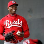 Reds reliever Aroldis Chapman smiles as he pitches Friday in Goodyear.