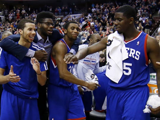 From left to right, Philadelphia 76ers' Michael Carter-Williams, Nerlens Noel, Hollis Thompson and Henry Sims celebrate in the final seconds of an NBA basketball game against the Detroit Pistons, Saturday, March 29, 2014, in Philadelphia. Philadelphia won 123-98, breaking a 26-game losing streak.