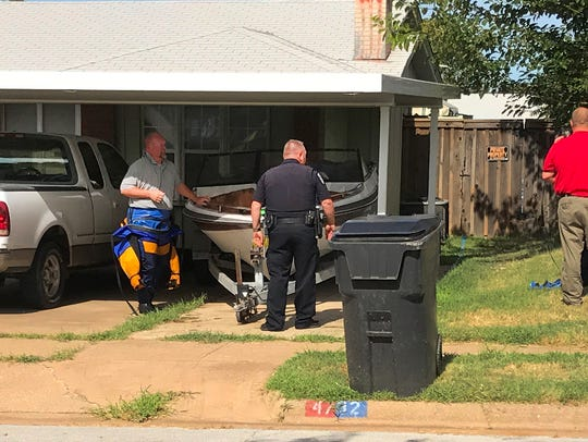 Wichita Falls police work the scene of a possible drowning