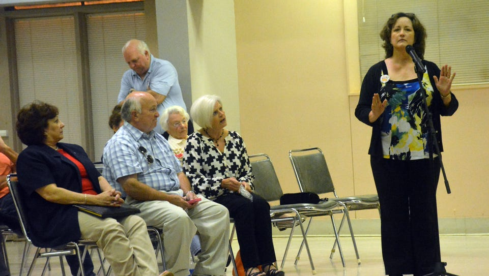 Debbie Vailes speaks at a town hall meeting hosted