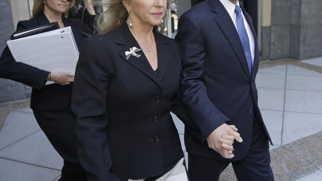 Former Virginia Gov. Bob McDonnell, right, and his wife Maureen, center, leave Federal court after a motions hearing in Richmond, Va., Monday, May 19, 2014. The Republican former governor and his wife are charged in a 14-count indictment with accepting more than $165,000 from Jonnie Williams, the former CEO of dietary supplements maker Star Scientific Inc., in exchange for helping promote his products. They have pleaded not guilty.