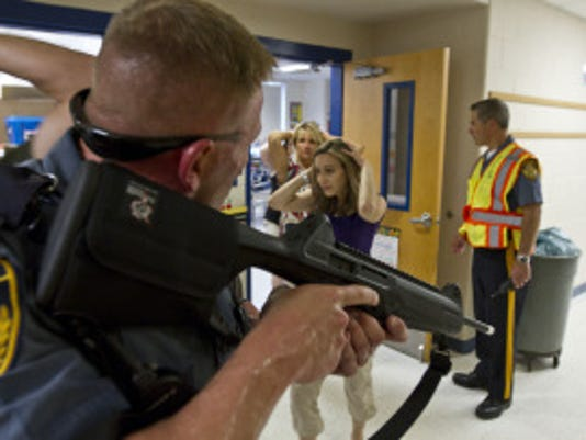 The Ocean Township Police Department holds a lock down and search drill involving simulated gunfire at Wanamassa Elementary School in 2014. (Doug Hood/Staff Photographer)