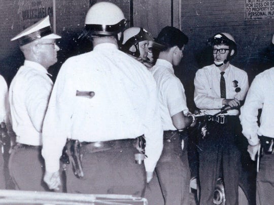 Cincinnati police officers, accompanied by Ohio National Guard troops, were called upon to restore order during 1967 Cincinnati riot.