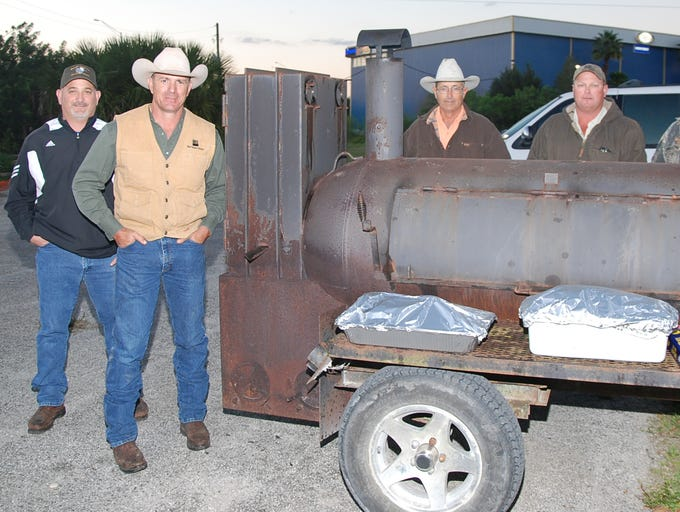 From left, grill masters Keith Barton, George Kempfer, Ronnie Arnold, Doug Platt and David Webb pose for a photo during the Brevard County 2014 4-H Youth Foundation Country Hoedown fundrasier Feb. 28 at the County Line Saloon on New Haven Ave. in Melbourne.