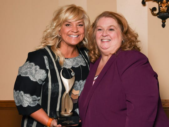 Christy Tripp, left, accepted the ATHENA Award from