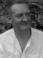 Author Giles Milton.