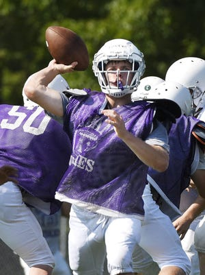 Albany quarterback Taylor Fourre throws to a receiver on a play during practice.