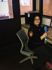 Emily Longoria, of Fremont, works in the control room of the Sandusky County Jail.