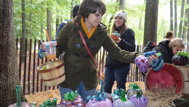 Heather McCauley of Atco attends the Festival of Fine Craft at Wheaton Arts adds to her glass pumpkin collection.