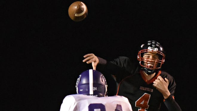 Rocori quarterback Connor Schoborg throws a pass over Little Falls'  Jesse Mrosla in the first half during the Oct. 13 game in Cold Spring.
