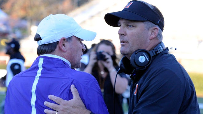 Furman coach Bruce Fowler, left, congratulates Mercer coach Bobby Lamb after the teams' game in 2015