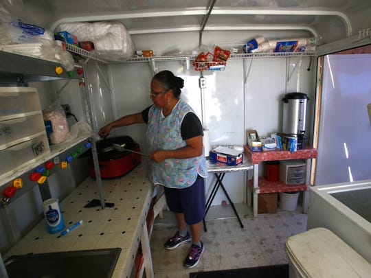 Roberta Atcitty checks on her stew on Monday at Atcitty Concessions at the Northern Navajo Nation Fairgrounds in Shiprock.