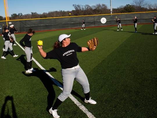 Augie Pena, left, warms up by throwing the ball with her teammates during AU's softball practice, on Thursday, January 26, 2017 in Anderson.