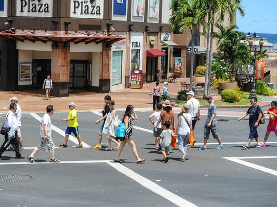 In this file phto, Guam visitors cross the intersection near the DFS T-Galleria in Tumon.
