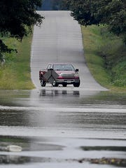 A motorist turns their turck around on Nance Road in Crockett County, Monday, Aug. 28. Heavy rains caused flooding throughout Crockett and Gibson County.
