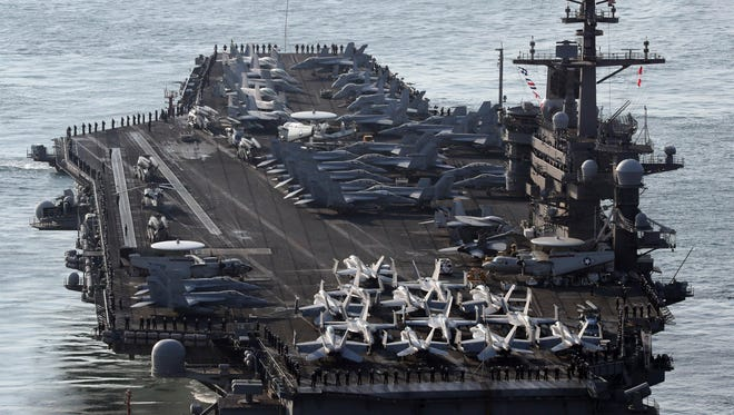 U.S. Navy aircraft carrier, the USS Carl Vinson approaches to join the annual joint military exercise called Foal Eagle between South Korea and the United States, at Busan port in Busan, South Korea, on March 15.