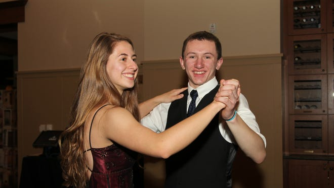 Hartland High School student Ron Mahan, right, and Summer Baut practice the Waltz, a favorite dance during The Dance Project's annual formal dance in March.