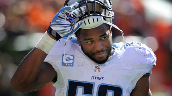 Titans inside linebacker Wesley Woodyard (59) walks back to the sideline as they lose 33 to 7 against the Bengals at Paul Brown Stadium Sunday Sept. 21, 2014, in Cincinnati, Oh.