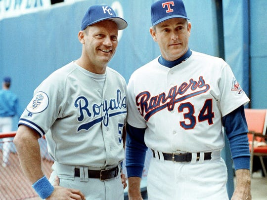 Former Kansas City Royals third baseman George Brett (left) and former Texas Ranges pitcher Nolan Ryan pose for a picture prior to the last game of their careers in 1993.