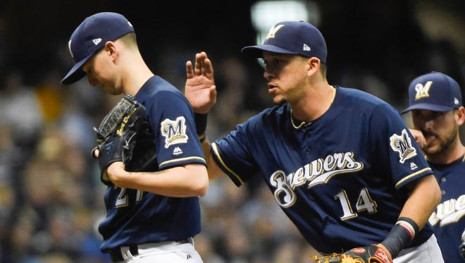 Brewers pitcher Zach Davies gets a pat on the back from shortstop Hernan Perez. Both players  made solid contributions in the Brewers' 9-1 victory on Tuesday night.