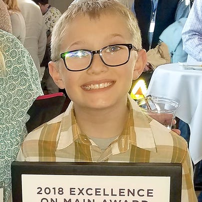 Ten-year-old Justin Dennis of Gig Harbor was awarded