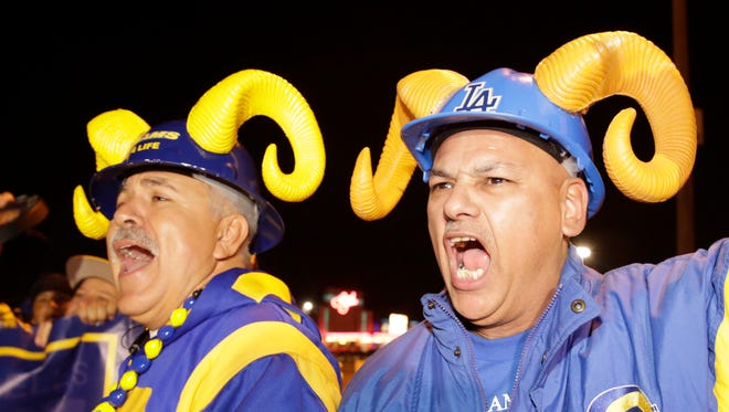 Football fans cheer for the return of the Rams to Los Angeles on the site of the old Hollywood Park horse-racing track in Inglewood, California, on Tuesday night.